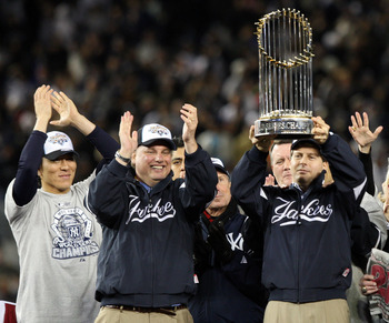 NEW YORK - NOVEMBER 04:  New York Yankees Managing General Partner Hal Steinbrenner of the New York Yankees celebrates with the trophy after their 7-3 win against the Philadelphia Phillies in Game Six of the 2009 MLB World Series at Yankee Stadium on Nove
