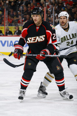 OTTAWA, ON - NOVEMBER 24: Alex Kovalev #27 of the Ottawa Senators follows the play in the corner while being closely watched by Brandon Segal #24 of the Dallas Stars in a game at Scotiabank Place on November 24, 2010 in Ottawa, Ontario, Canada. (Photo by