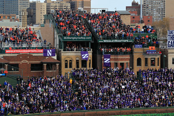 CHICAGO - NOVEMBER 20: Fans pack the right field bleachers and the roof tops to watch as the Northwestern Wildcats take on the Illinois Fighting Illini during a game played at Wrigley Field on November 20, 2010 in Chicago, Illinois. (Photo by Jonathan Dan