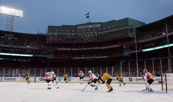 BOSTON, MA - JANUARY 01:  The Philadelphia Flyers skate against the Boston Bruins during the 2010 Bridgestone Winter Classic at Fenway Park on January 1, 2010  in Boston, Massachusetts.  (Photo by Jim McIsaac/Getty Images)