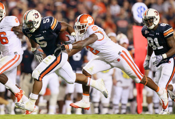 AUBURN, AL - SEPTEMBER 18:  Michael Dyer #5 of the Auburn Tigers against DeAndre McDaniel #2 of the Clemson Tigers at Jordan-Hare Stadium on September 18, 2010 in Auburn, Alabama.  (Photo by Kevin C. Cox/Getty Images)