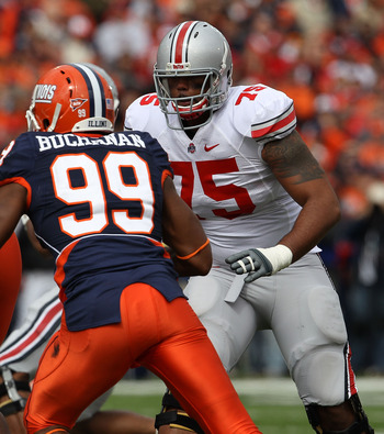CHAMPAIGN, IL - OCTOBER 02: Mike Adams #75 of the Ohio State Buckeyes prepares to block Michael Buchanan #99 of the Illinois Fighting Illini at Memorial Stadium on October 2, 2010 in Champaign, Illinois. Ohio State defeated Illinois 24-13. (Photo by Jonat