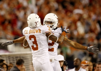 ARLINGTON, TX - DECEMBER 5:  Curtis Brown #3 and Earl Thomas #12 of the Texas Longhorns celebrate breaking up a pass against the Nebraska Cornhuskers in the third quarter at Cowboys Stadium on December 5, 2009 in Arlington, Texas.  (Photo by Ronald Martin