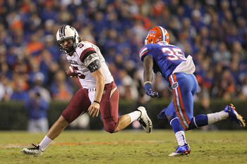 GAINESVILLE, FL - NOVEMBER 13:  Stephen Garcia #5 of the South Carolina Gamecocks rushes against Ahmad Black #35 of the Florida Gators during a game at Ben Hill Griffin Stadium on November 13, 2010 in Gainesville, Florida. The Gamecocks beat the Gators 36