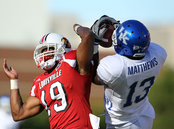 LOUISVILLE, KY - SEPTEMBER 04: Chris Matthews #13 of the Kentucky Wildcats catches a pass while defended by Johnny Patrick #19 of the Louisville Cardinals  during the game at Papa John's Cardinal Stadium on September 4, 2010 in Louisville, Kentucky.  (Pho