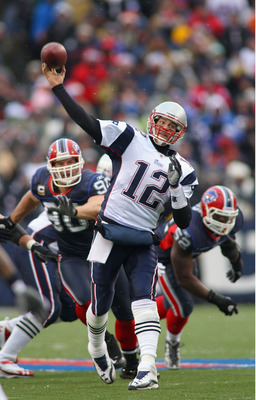 ORCHARD PARK, NY - DECEMBER 26:  Tom Brady #12 of the New England Patriots throws a pass against the Buffalo Bills  at Ralph Wilson Stadium on December 26, 2010 in Orchard Park, New York.  New England won 34-3.  (Photo by Rick Stewart/Getty Images)