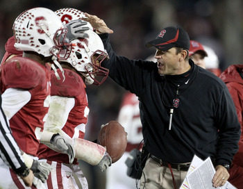 PALO ALTO, CA - NOVEMBER 27:  Head coach Jim Harbaugh congratulates Delano Howell #26 of the Stanford Cardinal after he made an interception on a pass intended for Joe Halahuni #87 of the Oregon State Beavers at Stanford Stadium on November 27, 2010 in Pa