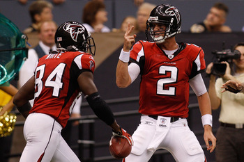 NEW ORLEANS - SEPTEMBER 26:  Matt Ryan #2 of the Atlanta Falcons celebrates after throwing a touchdown pass against the New Orleans Saints at the Louisiana Superdome on September 26, 2010 in New Orleans, Louisiana.  The Falcons defeated the Saints 27-24.