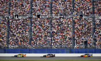DAYTONA BEACH, FL - FEBRUARY 17:  Kyle Busch, driver of the #18 M&M's Toyota, leads Denny Hamlin, driver of the #11 FedEx Toyota, and Jeff Gordon, driver of the #24 Dupont Chevrolet, during the NASCAR Sprint Cup Series Daytona 500 at Daytona International