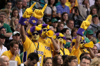 BOSTON - JUNE 13:  Fans of the Los Angeles Lakers cheer during Game Five of the 2010 NBA Finals against the Boston Celtics on June 13, 2010 at TD Garden in Boston, Massachusetts. NOTE TO USER: User expressly acknowledges and agrees that, by downloading an