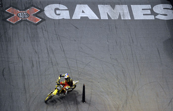 LOS ANGELES, CA - AUGUST 01:  Travis Pastrana competes to a gold medal in the Moto X Speed & Style Final during X Games 16 at Staples Center on August 1, 2010 in Los Angeles, California.  (Photo by Harry How/Getty Images)