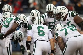 CHICAGO, IL - DECEMBER 26: Mark Sanchez #6 of the New York Jets calls a play in the huddle against the Chicago Bears at Soldier Field on December 26, 2010 in Chicago, Illinois. The Bears defeated the Jets 38-34. (Photo by Jonathan Daniel/Getty Images)