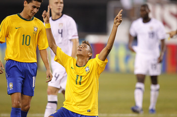 EAST RUTHERFORD, NJ - AUGUST 10:  Neymar #11 and Paulo Henrique Ganso #10 of Brazil celebrate Neymar's goal against the U.S. in the first half of a friendly match at the New Meadowlands on August 10, 2010 in East Rutherford, New Jersey.  (Photo by Jeff Ze