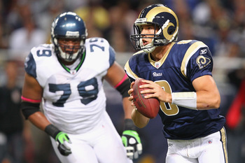ST. LOUIS - OCTOBER 3: Sam Bradford #8 of the St. Louis Rams scrambles against the Seattle Seahawks at the Edward Jones Dome on October 3, 2010 in St. Louis, Missouri.  The Rams beat the Seahawks 20-3.  (Photo by Dilip Vishwanat/Getty Images)