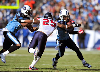 NASHVILLE, TN - DECEMBER 19:  Chris Johnson #28 of the Tennessee Titans braks away from Kareem Jackson #25 of the Houston Texans during the first half at LP Field on December 19, 2010 in Nashville, Tennessee.  (Photo by Grant Halverson/Getty Images)