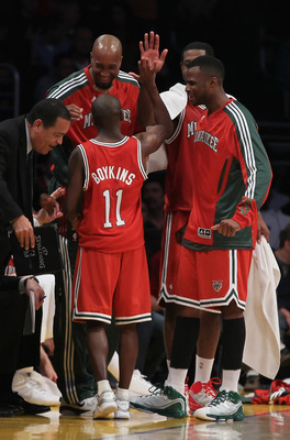 LOS ANGELES, CA - DECEMBER 21:  Earl Boykins #11 of the Milwaukee Bucks receives high fives from his teammates on the bench during the second half against the Los Angeles Lakers at Staples Center on December 21, 2010 in Los Angeles, California. The Bucks