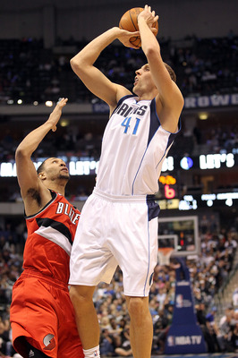 DALLAS, TX - DECEMBER 15: Forward Dirk Nowitzki #41 of the Dallas Mavericks takes a shot against Brandon Roy #7 of the Portland Trail Blazers at American Airlines Center on December 15, 2010 in Dallas, Texas.  NOTE TO USER: User expressly acknowledges and