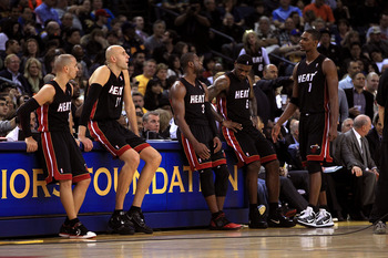 OAKLAND, CA - DECEMBER 10: Carlos Arroyo #8, Zydrunas Ilgauskas #11, Dwyane Wade #3, LeBron James #6 and Chris Bosh #1 of the Miami Heat wait on the side of the court during a time out of their game against the Golden State Warriors at Oracle Arena on Dec