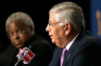 SAN ANTONIO - JUNE 21:  (L-R) Billy Hunter, President of the NBA Players Association, looks on as NBA commissioner David Stern speaks at a press conference announcing that the NBA and the NBA Players Association have agreed in principal on a new 6-year Co