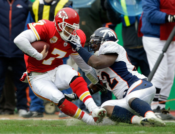KANSAS CITY, MO - DECEMBER 06:  Quarterback Matt Cassel #7 of the Kansas City Chiefs is sacked by Elvis Dumervil #92 of the Denver Broncos during the game on December 6, 2009 at Arrowhead Stadium in Kansas City, Missouri.  (Photo by Jamie Squire/Getty Ima