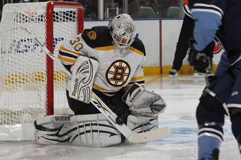 SUNRISE, FL - DECEMBER 27: Goaltender Tim Thomas #30 of the Boston Bruins stops a shot by Michael Santorelli #13 of the Florida Panthers  on December 27, 2010 at the BankAtlantic Center in Sunrise, Florida. The Bruins defeated the Panthers 3-2 in a shoot-