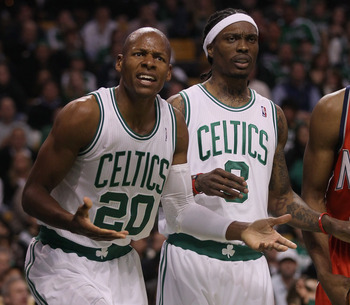 BOSTON - NOVEMBER 24:  Ray Allen #20 of the Boston Celtics reacts to a call in the first quarter against the New Jersey Nets on November 24, 2010 at the TD Garden in Boston, Massachusetts. Teammate Marquis Daniels #8 of the Celtics stands by. NOTE TO USER