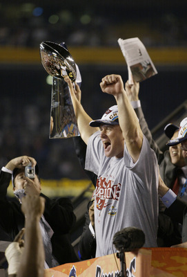 SAN DIEGO - JANUARY 26:  Head Coach Jon Gruden of the Tampa Bay Buccaneers holds up the Vince Lombardi Trophy after his team defeated the Oakland Raiders in the Super Bowl XXXVII at Qualcomm Stadium on January 26, 2003 in San Diego, California.  The Bucca