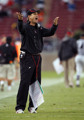 PALO ALTO, CA - OCTOBER 23:  Head coach Jim Harbaugh of the Stanford Cardinal aruges with the referees during their game against the Washington State Cougars at Stanford Stadium on October 23, 2010 in Palo Alto, California.  (Photo by Ezra Shaw/Getty Imag