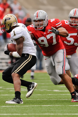 COLUMBUS, OH - OCTOBER 23:  Cameron Heyward #97 of the Ohio State Buckeyes chases down ballcarrier Keith Carlos #1 of the Purdue Boilermakers at Ohio Stadium on October 23, 2010 in Columbus, Ohio.  (Photo by Jamie Sabau/Getty Images)