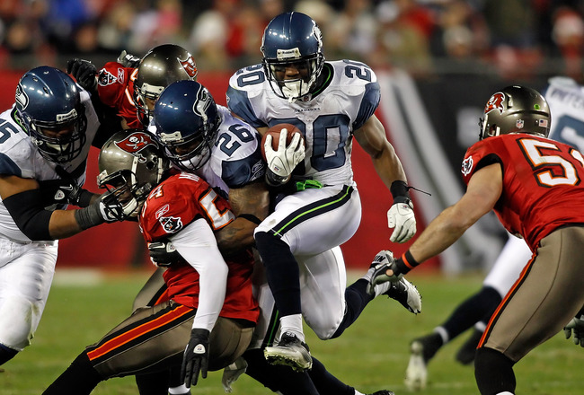 TAMPA, FL - DECEMBER 26:  Running back Justin Forsett #20 of the Seattle Seahawks runs the ball against the Tampa Bay Buccaneers during the game at Raymond James Stadium on December 26, 2010 in Tampa, Florida.  (Photo by J. Meric/Getty Images)