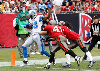 TAMPA, FL - DECEMBER 19:  Receiver Nate Burleson #13 of the Detroit Lions scores a touchdown in front of defenders Corey Lynch #41 and E.J. Biggers #31 of the Tampa Bay Buccaneers during the game at Raymond James Stadium on December 19, 2010 in Tampa, Flo