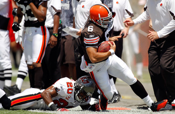 TAMPA, FL - SEPTEMBER 12:  Defensive back Ronde Barber #20 of the Tampa Bay Buccaneers knocks quarterback Seneca Wallace #6 of the Cleveland Browns out of bounds during the NFL season opener game at Raymond James Stadium on September 12, 2010 in Tampa, Fl