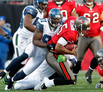 TAMPA, FL - DECEMBER 26: Defensive end Chris Clemons #91 of the Seattle Seahawks sacks quarterback Josh Freeman #5 of the Tampa Bay Buccaneers during the game at Raymond James Stadium on December 26, 2010 in Tampa, Florida. (Photo by J. Meric/Getty Images
