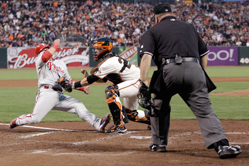 Buster Posey tagging out Carlos Ruiz at the plate during Game 4 of the 2010 NLCS.