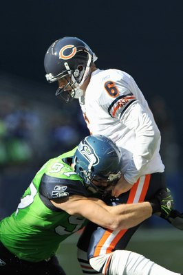 SEATTLE - SEPTEMBER 27: Quarterback  Jay Cutler 36 of the Chicago Bears is sacked by Patrick Kerney #97 of the Seattle Seahawks on September 27, 2009 at Qwest Field in Seattle, Washington. The Bears defeated the Seahawks 25-19.  (Photo by Otto Greule Jr/G