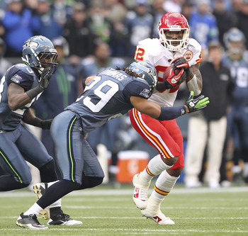 SEATTLE - NOVEMBER 28:  Wide receiver Dwayne Bowe #82 of the Kansas City Chiefs rushes against Earl Thomas #29 and Marcus Trufant #23 of the Seattle Seahawks at Qwest Field on November 28, 2010 in Seattle, Washington. The Chiefs defeated the Seahawks 42-2