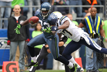 SEATTLE - SEPTEMBER 26:  Wide receiver Deion Branch #83 of the Seattle Seahawks looses possession of the ball as he crosses the goal line against Paul Oliver #27 of the San Diego Chargers at Qwest Field on September 26, 2010 in Seattle, Washington. The to