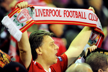 LIVERPOOL, ENGLAND - DECEMBER 15:  A Liverpool fan cheers on his team during the UEFA Europa League Group K match between Liverpool and FC Utrecht at Anfield on December 15, 2010 in Liverpool, England.  (Photo by Clint Hughes/Getty Images)