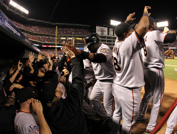 The Giants celebrate as Juan Uribe comes back to the dugout after Edgar Renteria hits a three-run home run in Game 5 of the 2010 World Series.