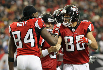 ATLANTA - NOVEMBER 28:  Matt Bryant #3, Roddy White #84 and Tony Gonzalez #88 of the Atlanta Falcons react after Bryant's go-ahead field goal in the final seconds against the Green Bay Packers at Georgia Dome on November 28, 2010 in Atlanta, Georgia.  (Ph
