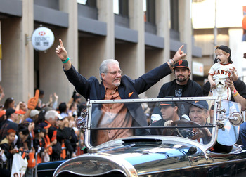 Giants' General Manager Brian Sabean salutes the crowd during the World Series victory parade.