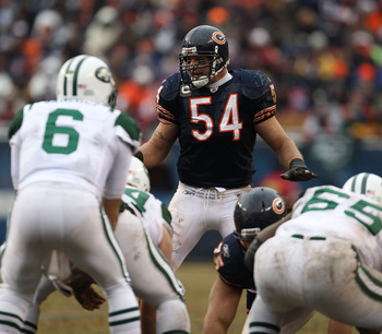 CHICAGO, IL - DECEMBER 26: Brian Urlacher #54 of the Chicago Bears awaits the start of play as Mark Sanchez #6 of the New York Jets calls offensive signals at Soldier Field on December 26, 2010 in Chicago, Illinois. The Bears defeated the Jets 38-34. (Pho