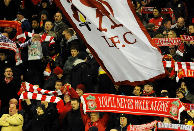 LIVERPOOL, ENGLAND - DECEMBER 15:  Liverpool fans cheer on their team during the UEFA Europa League Group K match between Liverpool and FC Utrecht at Anfield on December 15, 2010 in Liverpool, England.  (Photo by Clint Hughes/Getty Images)