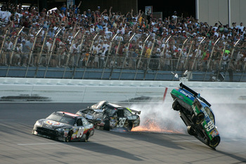 Brad Keselowski (09) earned his first NASCAR Sprint Cup win as he buried the throttle and held his line.  This vaulted Carl Edwards into the catch fence at Talladega.
