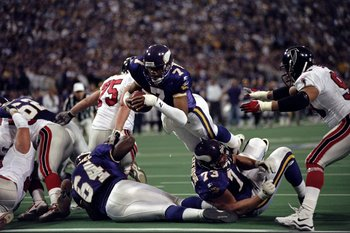 17 Jan 1999: Randall Cunningham #7 of the Minnesota Vikings jumps to make a touchdown during the NFC Championship Game against the Atlanta Falcons at the H. H. H. Metrodome in Minneapolis, Minnesota. The Falcons defeated the Vikings 30-27. Mandatory Credi