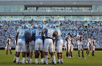 CHAPEL HILL, NC - NOVEMBER 13:  The North Carolina Tar Heels huddle against the Virginia Tech Hokies during their game at Kenan Stadium on November 13, 2010 in Chapel Hill, North Carolina.  (Photo by Streeter Lecka/Getty Images)