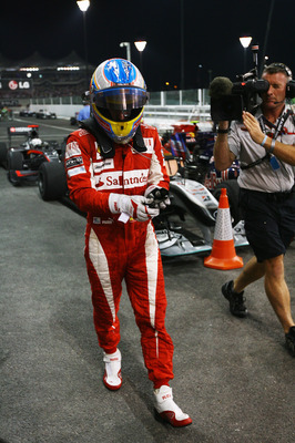 ABU DHABI, UNITED ARAB EMIRATES - NOVEMBER 14:  Fernando Alonso of Spain and Ferrari reacts in parc ferme following the Abu Dhabi Formula One Grand Prix at the Yas Marina Circuit on November 14, 2010 in Abu Dhabi, United Arab Emirates.  (Photo by Ker Robe