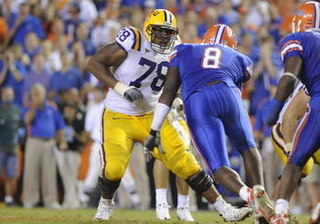 LSU offensive tackle Joseph Barksdale in action against former Florida Gator Carlos Dunlap