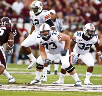 Auburn left tackle Lee Ziemba, No. 73, making reading for pass protection.