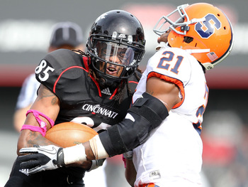 CINCINNATI - OCTOBER 30:  Marcus Barnett #85 of the Cincinnati Bearcats is tackled by Shamarko Thomas #21 of the Syracuse Orange during the Big East Conference game at Nippert Stadium on October 30, 2010 in Cincinnati, Ohio.  (Photo by Andy Lyons/Getty Im